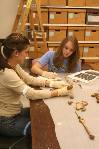 Anthropology majors Luciana Mendiola and Emily Sharp analyze  archaeological specimens in the Osteology Research Lab.
