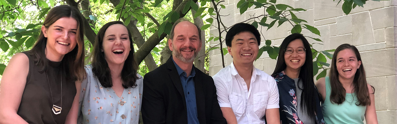 undergraduate Economics honors students with faculty member Mario Crucini